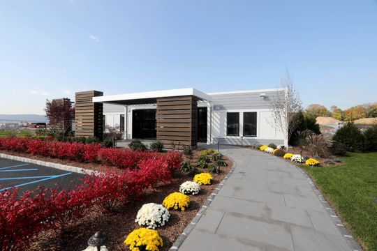 The sales office for Edge-on-Hudson, photographed Oct. 23, 2018, a new residential development planned for the site of the former General Motors assembly plant in Sleepy Hollow, has been completed and is set to open. Toll Brothers, the company developing the site, has begun construction of townhomes. Infrastructure work, the planting of grass, as well as pile driving for foundations is under way.
